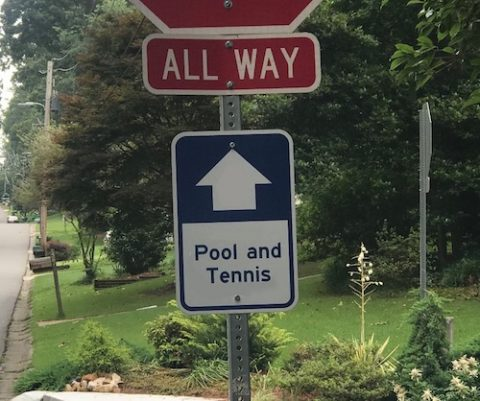 Can your pool put up permanent street signs around the neighborhood